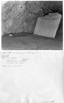 Jan 11/60 a partly poured tailings fill - (Jack Heit) Dad on safety demonstrating how fill was pu...