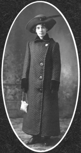 Unidentified woman in a coat