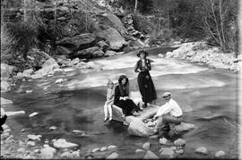 Family in mountain stream
