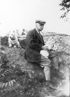 Unidentified man with three dogs