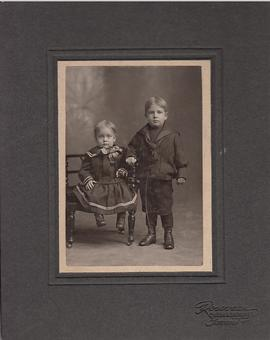 Photograph of a toddler and a little boy