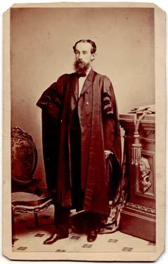Photograph of unidentified man wearing gown